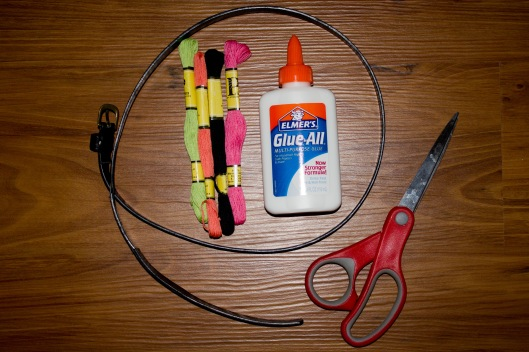 belt, thread, scissors, and glue
